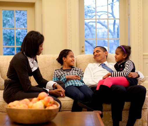 "Possibly the most compelling one. A shot of the President snuggling with his daughters on the couch next to his wife, looking ridiculously happy. The caption from his campaign simply read: ""The most important meeting of the day."""