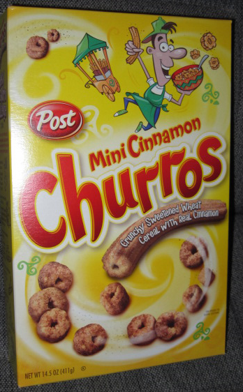 [A nearly-Latino-looking leprechaun gentleman cavorts on the front of a cereal box, all in green, surrounded by green Celtic swirls and what is evidently a green churro cart.]